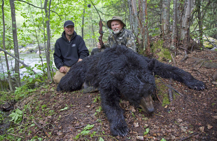 "Carney Easter and Kolby Morrison with Carney's 20 4/16"" bear."