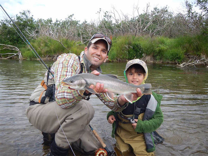Don Trump Jr. fly fishing with his son.