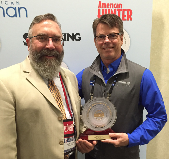 Joel Harris (right) accepts the the 2016 Golden Bullseye Award from Scott Olmsted, Editor in Chief, NRA American Hunter for Optic of the Year.