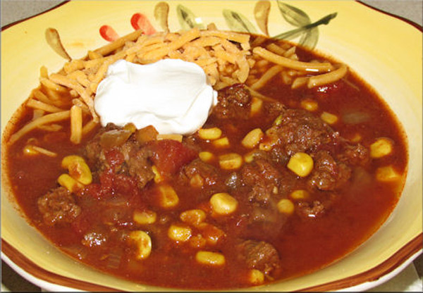 This is how I love my chili... a little cheese and a dollop of Daisy sour cream.