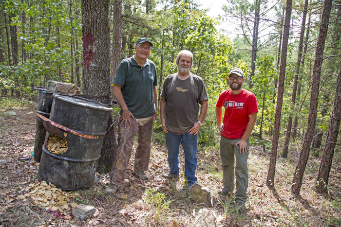 Gary Newcomb, James Lawrence and Clay Newcomb stand beside the bait site in Oklahoma. Baiting bear and is extreme amount work and a very challenging hunt, especially in the fall.