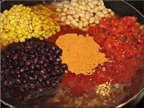 Add one package taco seasoning added to our pot and now to mix it all up and start cooking.