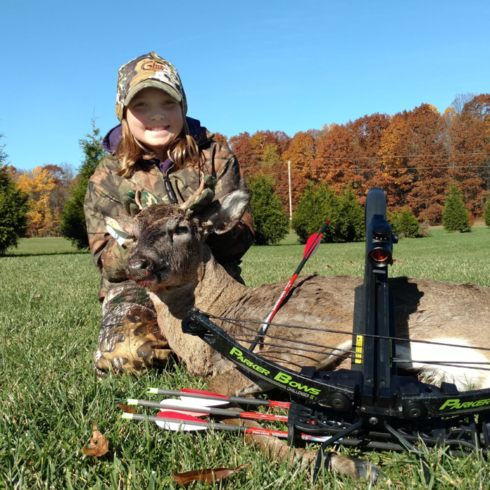 Abby is all smiles as she poses with her buck. She is happy, Dad is proud and the next generation of hunters is secure.